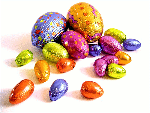 Clipart of a collection of different colored chocolate wrapped in blue, pink, yellow, orange and purple tinfoil. This clipart makes a really great Easter card cover, Click here to get more Free Clipart at ClipartPal.com